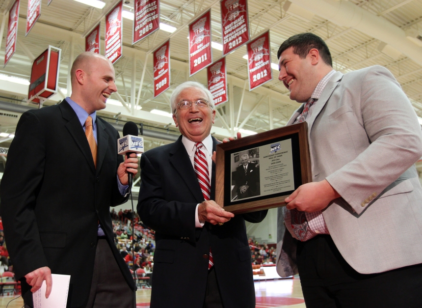 Don Cook received his NEC Hall of Fame plaque on TV during a January MBB broadcast from SHU's Pitt Center.