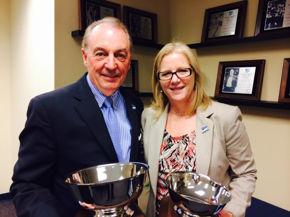 Bryant University's Ron Machtley received the Brenda Weare Commissioner's Cup at NEC headquarters last June. He'll keep it for another year.