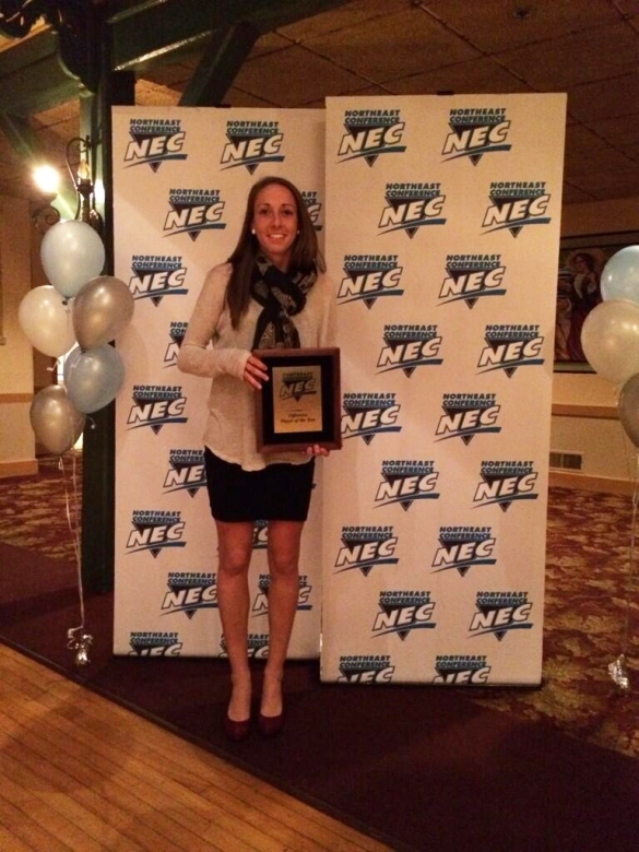 Tesa McKibben (above) is shown accepting the #NECWSOC Player of the Year award for a fourth time.