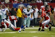 Miles Austin (14) of the Dallas Cowboys during the Cowboys 38-28 win over the Atlanta Falcons at the Georgia Dome in Atlanta, Georgia. Photo by James D. Smith - 16 December 2006